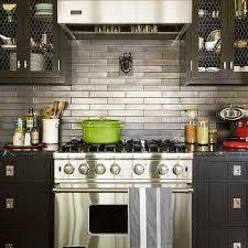 Kitchen With Stainless Steel Backsplash Black Kitchen Door Transitional Kitchen Jenny Wolf Interiors
