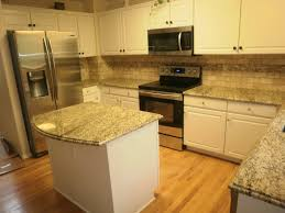 granite countertop knotty alder cabinet white tile backsplash