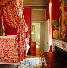 colorful red bedroom in french chateau jacques garcia design
