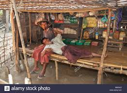 chin tribesmen resting in their home and shop in a small village