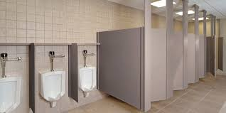 white solid wood toilet partitions combined with ceiling light on