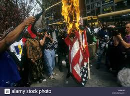 Flag Burning Protest Protesters Burn United States Flag During An Anti Racism Stock