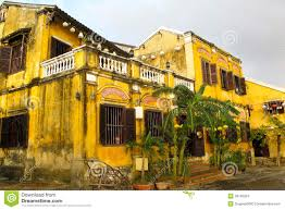 yellow french colonial style house in hoi an vie stock images