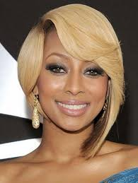 pic of black women side swept bangs and bun hairstyle cute asymmetrical bob haircuts with side swept bangs for black