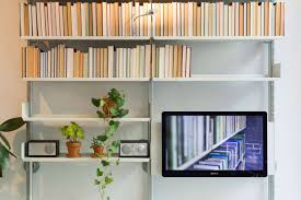 here a tv is integrated into a shelving system via our mounting