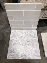 grey glass subway tile backsplash and white cabinet for small agora piastrella sage ceramic backsplash and cabria berwyn quartz slab