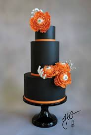 a creepy chic halloween cake with eyeball peonies and skeleton