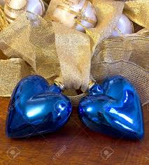 two blue hearts and christmas decorations stock photo picture and