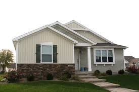 One Story Home Mastic White Vertical Siding White Trim Green Board And Batten