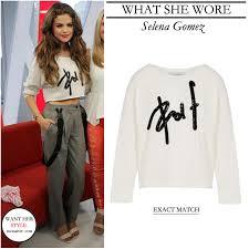 selena gomez sweater what she wore selena gomez wore a white cropped logo print