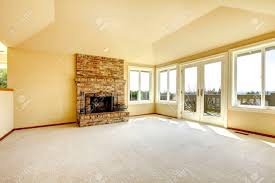 vaulted ceiling living room bright empty living room with high vaulted ceiling and carpet