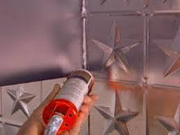How To Put Up Tin Ceiling Tiles by How To Create A Tin Tile Backsplash Hgtv