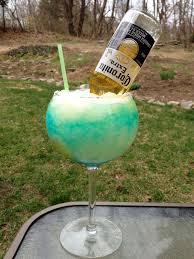 blue raspberry margarita one of our margaritas with an ice cold corona in it uh yeah
