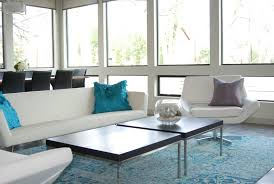 modern white faux leather sofa set with turquoise cushins combined