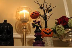 decorating for halloween a spooky bookshelf and fireplace mantle