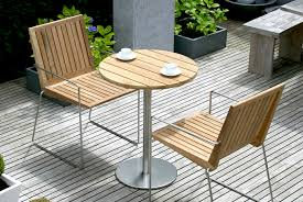 Steel Bistro Chairs Modern Bistro Table In Teak And Stainless Steel Shown Here With