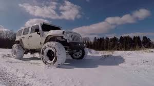 custom off road jeep 100 000 custom jeep wrangler drifting off road in the snow