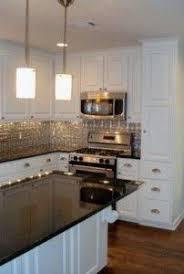Embossed Tin Backsplash by White Cabinets Grey Counter Tin Backsplash Design Pictures