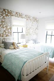adorable shared kids u0027 room features white and taupe floral