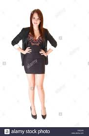 Short Skirts High Heels A Lovely Young Businesswoman In A Short Skirt And Dark Gray Blazer