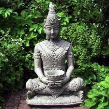 serene buddha with vase garden statues