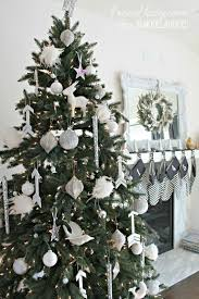 all white tree with diy wooden arrow ornaments 4men1lady