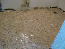 ambelish 31 bathroom with pebble floor on shower floor tile