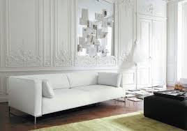 living room white leather sofa white cushions black coffee table