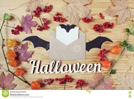 top view of a halloween wooden desk top with paper envelope bat