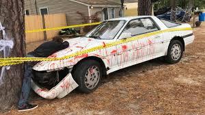 bloody toyota supra crash halloween display in new jersey sparks