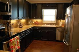 Black And Brown Kitchen Cabinets Brown And Black Kitchen Designs Kitchen Kitchen Cabinets Black