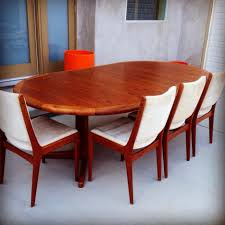 pretty teak dining table with 4 teak dining chairs white cushions
