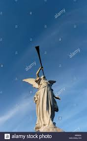 statue of an angel blowing a trumpet stock photo royalty free