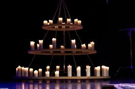 large round wood and iron chandelier with candles and hanging from ceiling with chains for dining room lighting ideas