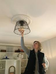 our lightbulb moment creating a diy wire basket light fixture