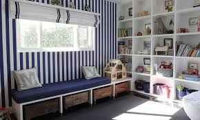 kids playroom furniture striped walls and different storage system for playroom