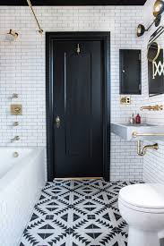 tile floor in bathroom and floor to ceiling subway tile walls