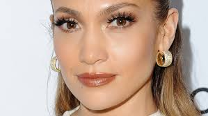 jlo earrings shares the secrets enviable glow you ll