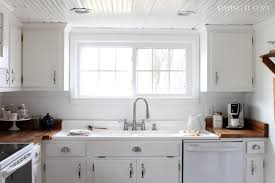 Antique White Cabinets With White Appliances by Keeping It Cozy Our Farmhouse Kitchen