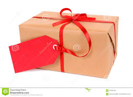 christmas gift or parcel tied with red ribbon and gift tag
