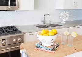white kitchen cabinets with white glass tile backsplash