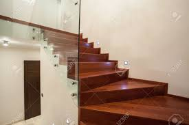 travertine house modern glass metal and wooden staircase stock