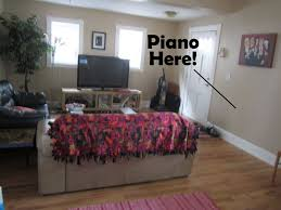 piano in living room beth s super awesome blog new living room arrangement with room
