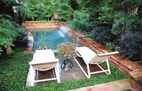 outdoor living small backyard pool design with mini waterfall