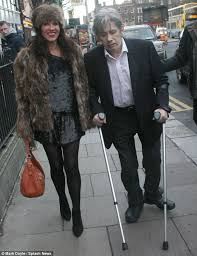 the pogues u0027 shane macgowan struggles on crutches as bono busks in