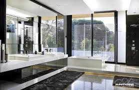 modern bathroom design at u shaped house design by saota and