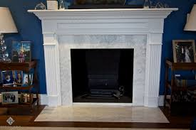 modern fireplace design with gray marble surround and white