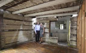 two story log homes owners discover home is preserved 19th century log cabin