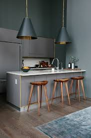 modern kitchen brooklyn wood barstools black pendant lighting with brass interiors in a