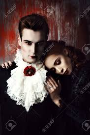 beautiful couple of vampires dressed in medieval clothing